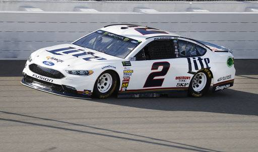 Brad Keselowski qualifies for the NASCAR Cup Series auto race in Brooklyn, Mich., Friday, Aug. 11, 2017. Keselowski won the pole. (AP Photo/Paul Sancya)
