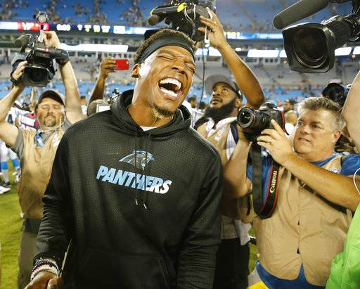 Carolina Panthers quarterback Cam Newton laughs after the second half of an NFL preseason football game against the Houston Texans, Wednesday, Aug. 9, 2017, in Charlotte, N.C. The Panthers won 27-17. (AP Photo/Jason E. Miczek)