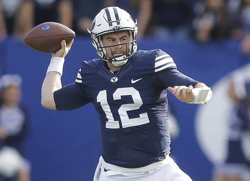 FILE - In this Nov. 12, 2016, file photo, BYU quarterback Tanner Mangum (12) throws a pass in the first half during an NCAA college football game against Southern Utah in Provo, Utah. (AP Photo/Rick Bowmer, File)