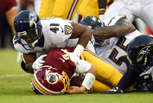 Baltimore Ravens cornerback Anthony Levine (41) sacks Washington Redskins quarterback Kirk Cousins in the first half of a preseason NFL football game, Thursday, Aug. 10, 2017, in Baltimore. (AP Photo/Gail Burton)