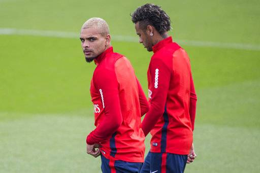 Paris Saint-Germain's Layvin Kurzawa, left, and Neymar arrive during a training session at the Camp des Loges training center in Saint Germain en Laye, west of Paris, Friday, Aug. 11, 2017. (AP Photo/Kamil Zihnioglu)
