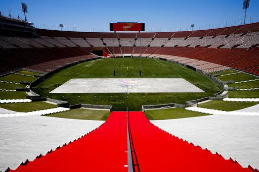 FILE - In this May 11, 2017, file photo, Los Angeles Memorial Coliseum, the venue proposed for Olympic opening and closing ceremonies and track and field events. stands in Los Angeles. The Los Angeles City Council is expected Friday, Aug. 11, 2017 to endorse a proposal to host the 2028 Olympics, following an announcement of a deal last month to leave 2024 to Paris. (AP Photo/Jae C. Hong, File)