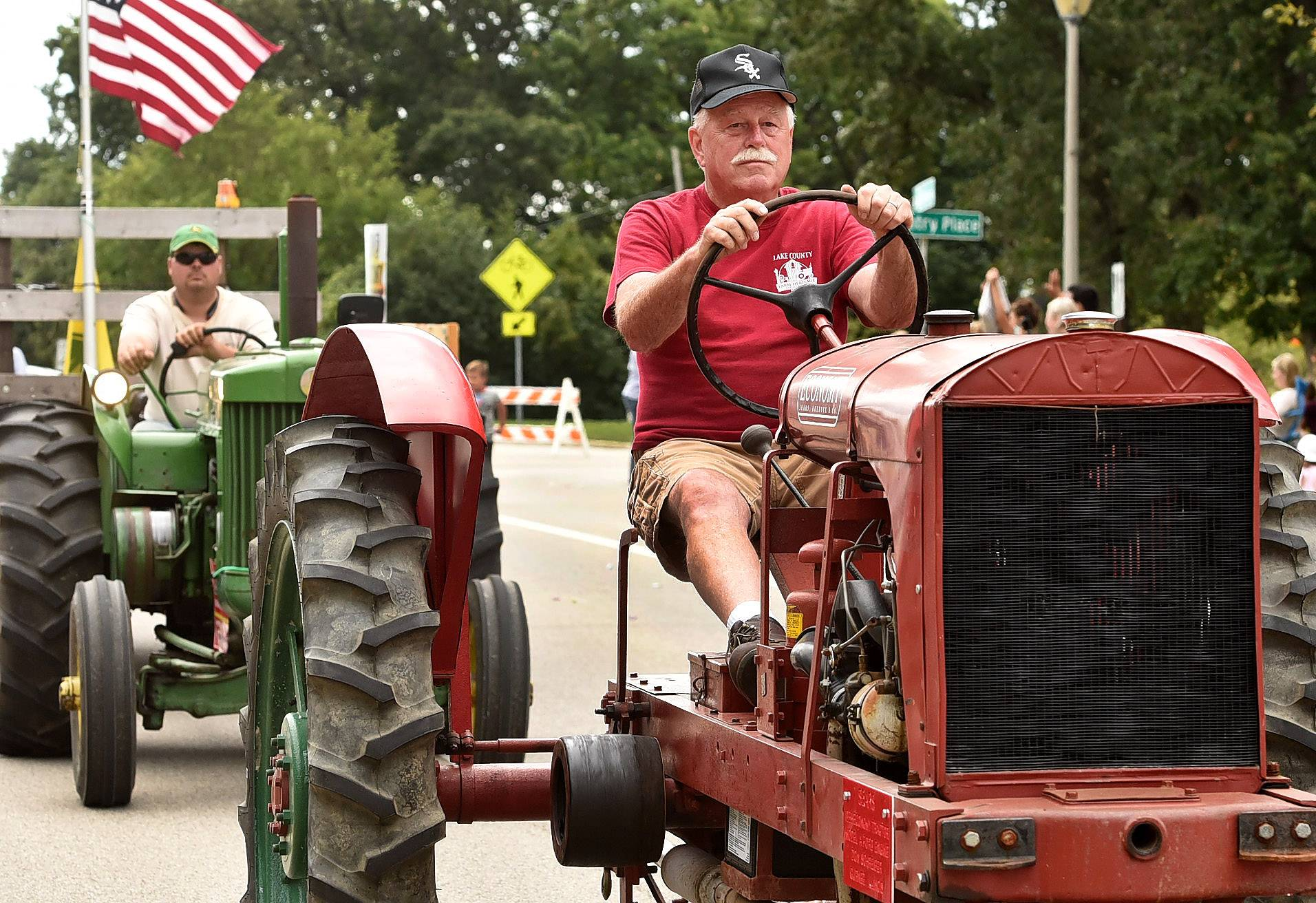 "Even though the parade theme was ""Go Cubs Go,"" that didn't keep White Sox fan Don Schreiber of the Lake County Farm Heritage Association from wearing his Sox hat during the Lindenfest parade Saturday."