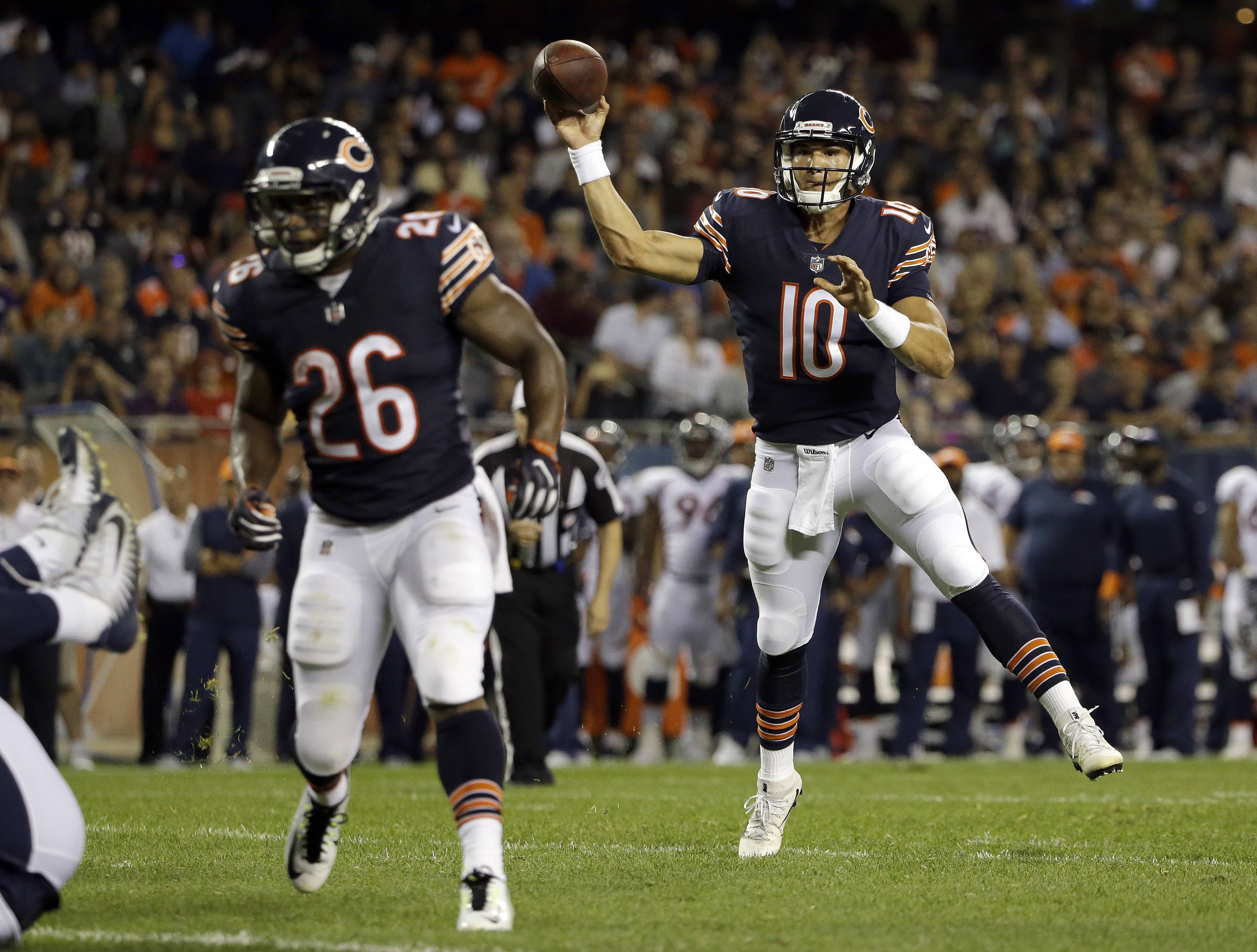 Chicago Bears quarterback Mitchell Trubisky (10) throws a touchdown pass to wide receiver Victor Cruz (80) during the first half of an NFL preseason football game against the Denver Broncos, Thursday, Aug. 10, 2017, in Chicago.