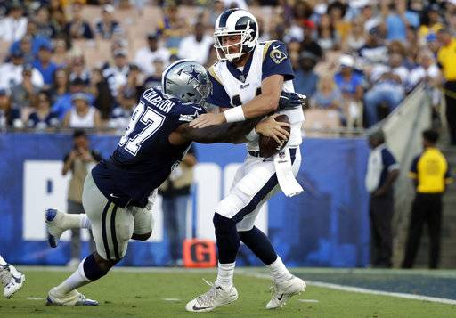 Dallas Cowboys defensive end Taco Charlton sacks Los Angeles Rams quarterback Sean Mannion during the first half of a preseason NFL football game Saturday, Aug. 12, 2017, in Los Angeles.