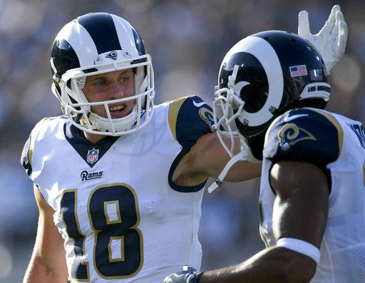Los Angeles Rams wide receiver Cooper Kupp (18) celebrates with teammate wide receiver Robert Woods, right, after scoring off a fumble recovery during the first half of a preseason NFL football game against the Dallas Cowboys, Saturday, Aug. 12, 2017, in Los Angeles.