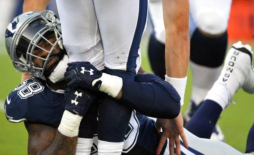 Dallas Cowboys defensive end Damontre Moore wraps up Los Angeles Rams quarterback Sean Mannion during the first half of a preseason NFL football game Saturday, Aug. 12, 2017, in Los Angeles.