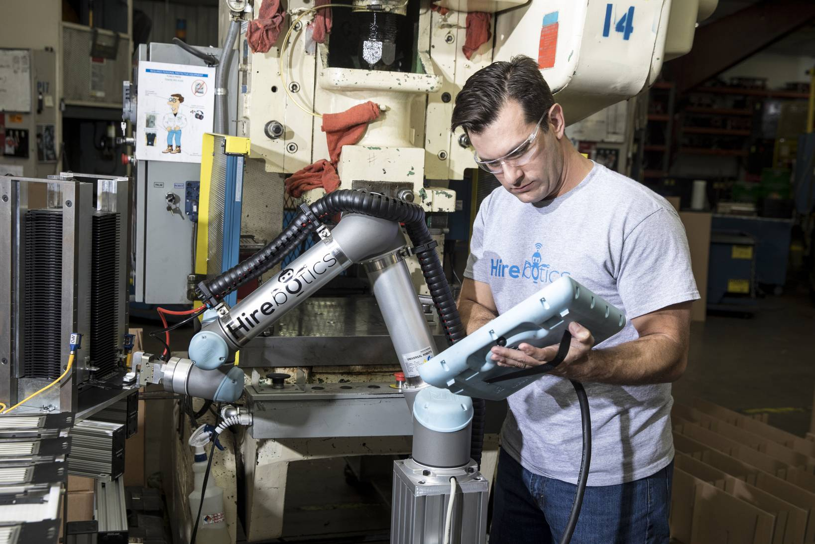 Rob Goldiez, co-founder of Hirebotics, configures a robot at Tenere Inc. in Dresser, Wisconsin.