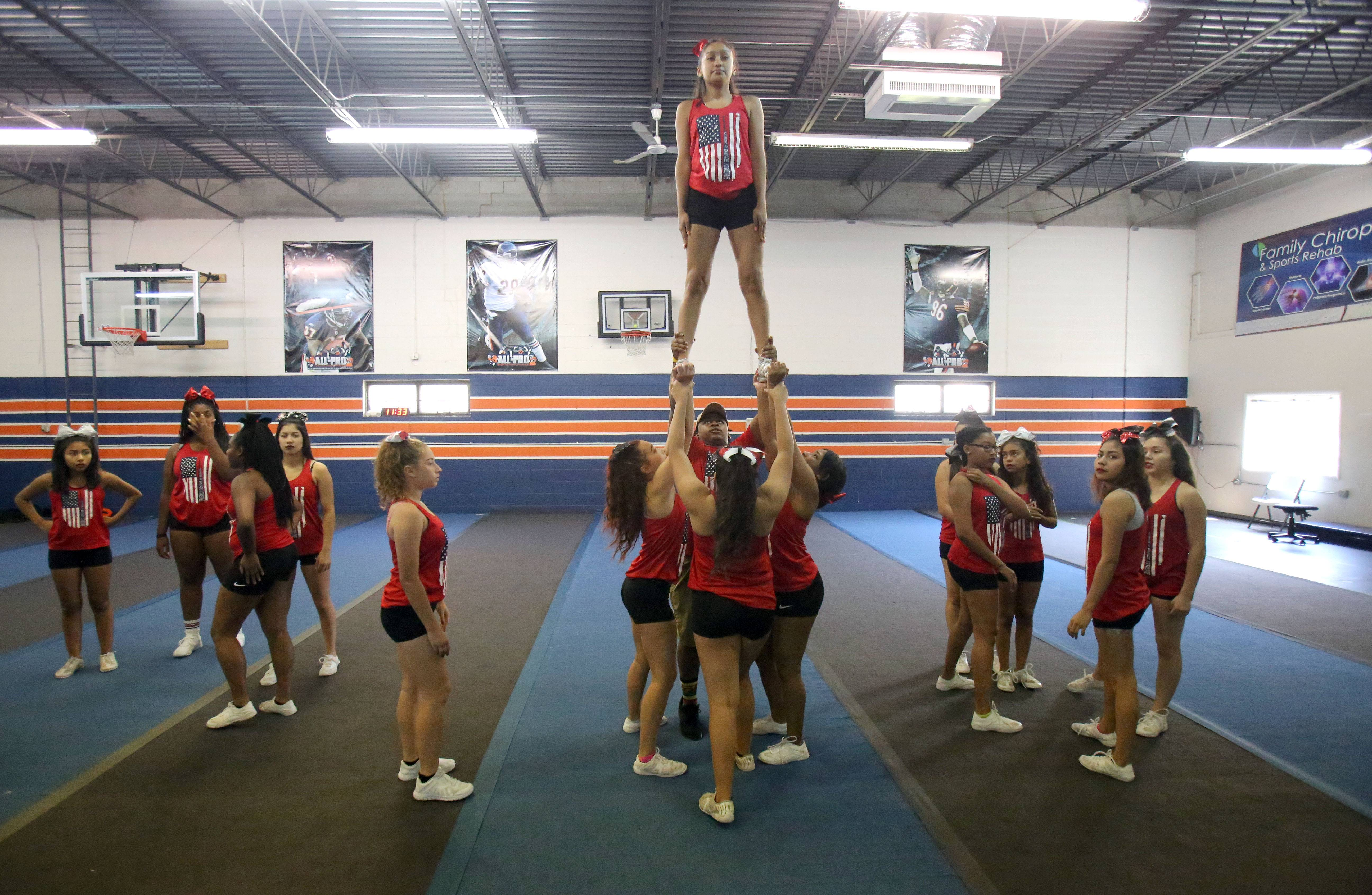 The Cheer & Dance Xtreme senior team practices in Gurnee. The team has been invited to perform in the annual Macy's Thanksgiving Day Parade in New York City, but the trip is going to be expensive, and many of the teens are struggling to come up with the necessary cash.