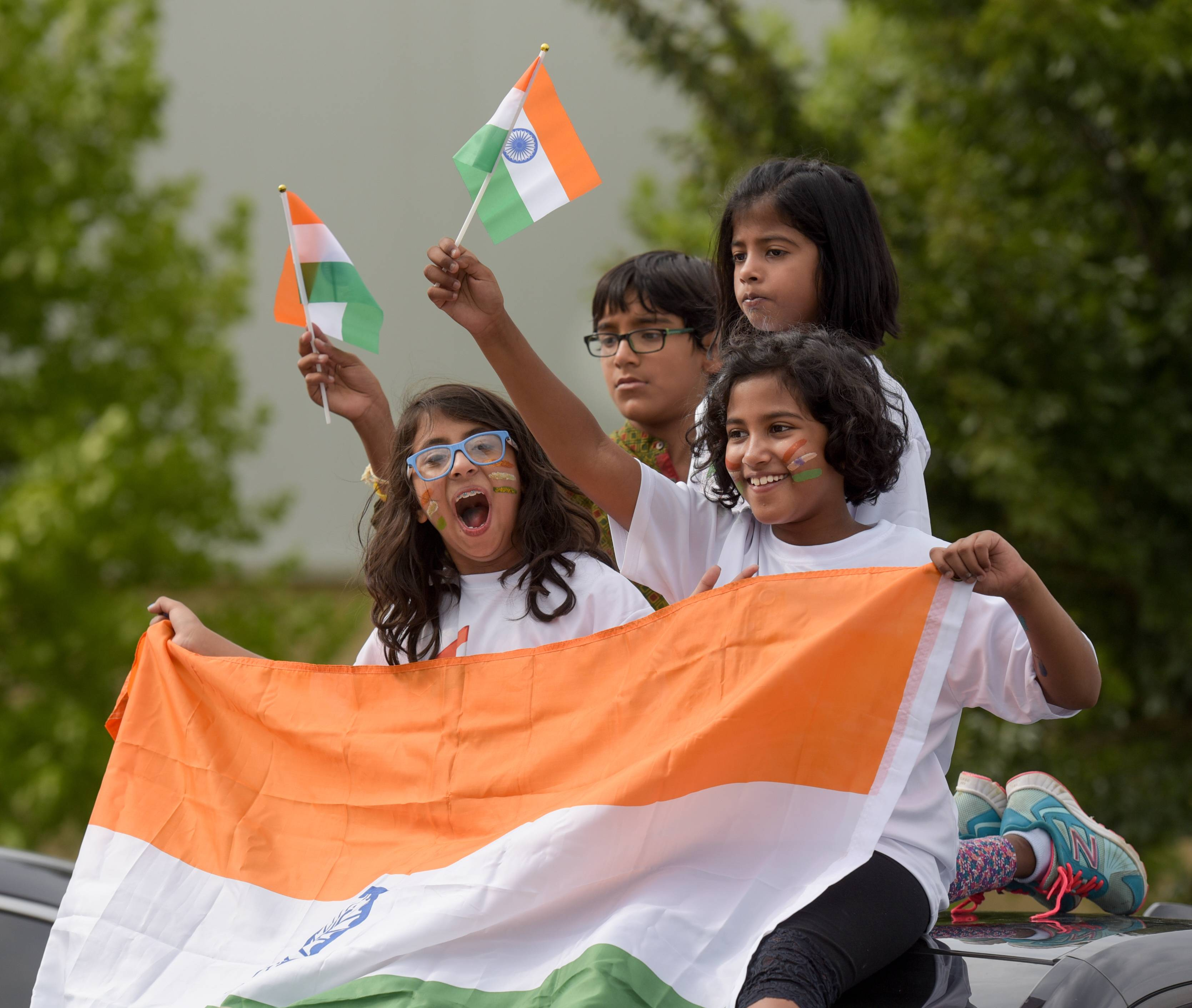 Arjun Mody, Dhiti Boggaram, Sanah Wagle and Aadya Boggaram cheer Sunday while watching the third annual India Day Parade and Festival in Naperville.