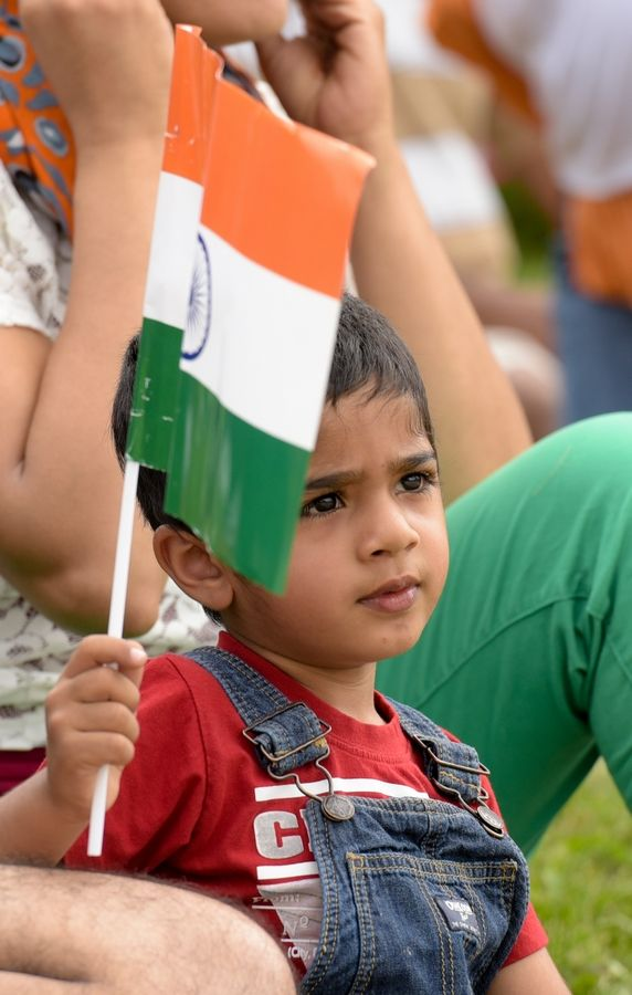Rohan Butani, 3, of Naperville waves an Indian Flag on Sunday during third annual India Day Parade in Naperville.