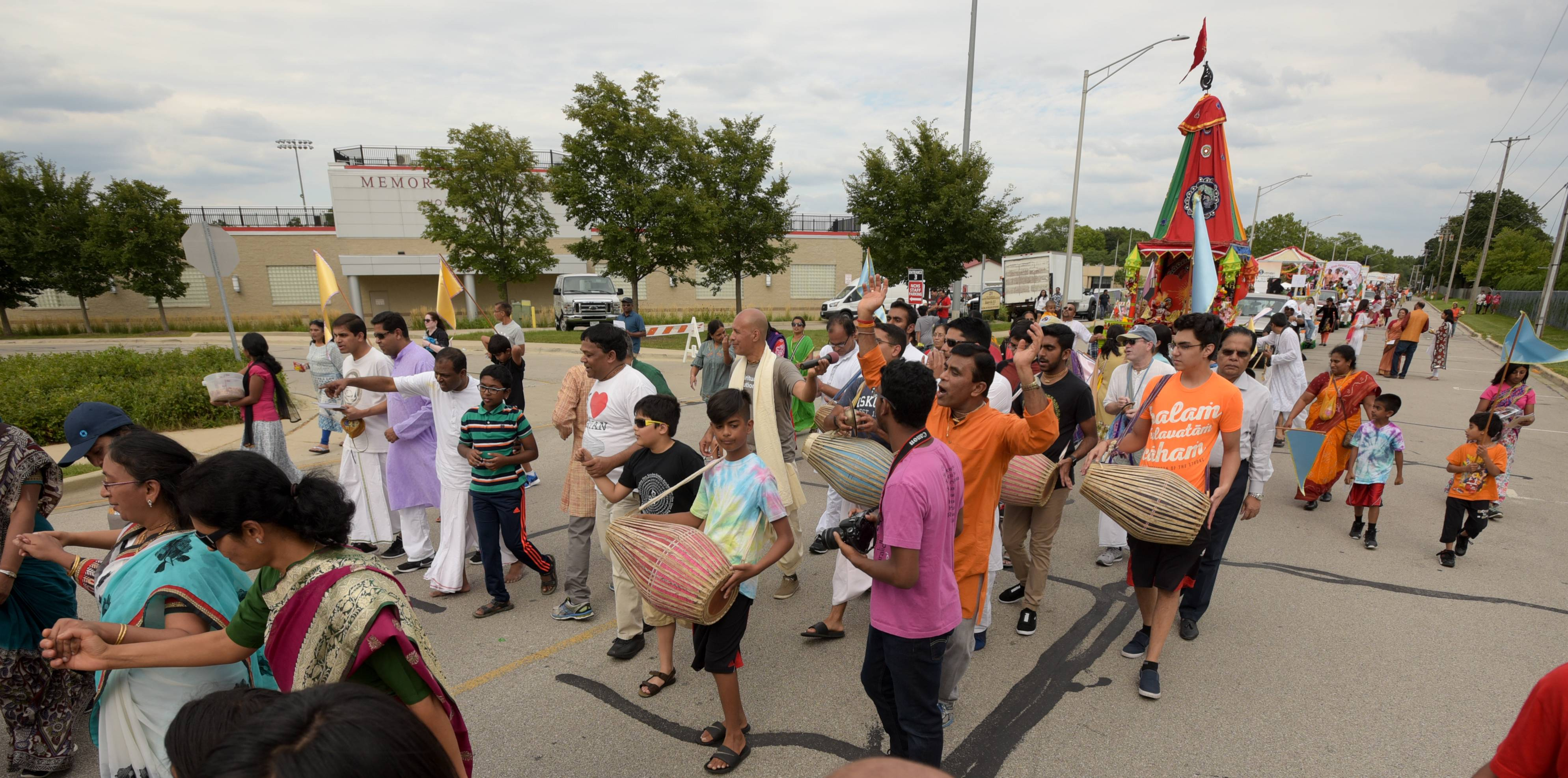 Members of the International Society for Krishna Consciousness, also known as the Hare Krishna movement, march Sunday in the third annual India Day Parade and Festival in Naperville.
