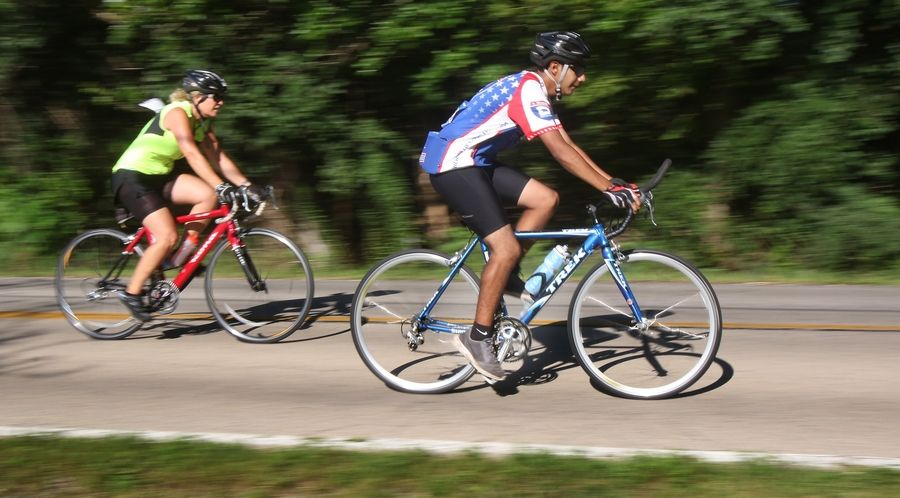 Cyclists pedal along Old Sutton Road during the 2017 Project Hero Barrington Honor Ride in Barrington Hills on Sunday. The event drew riders from the 500-mile UnitedHealthcare Great Lakes Challenge that began in Minnesota and ends Monday in Evanston.