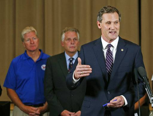 Charlottesville Mayor Mike Signer, right, gestures during a news conference concerning the white nationalist rally and violence as Virginia Gov. Terry McAuliffe, center, and Virginia Secretary of Public safety Brian Moran, left, listen in Charlottesville, Va., Saturday, Aug. 12, 2017.
