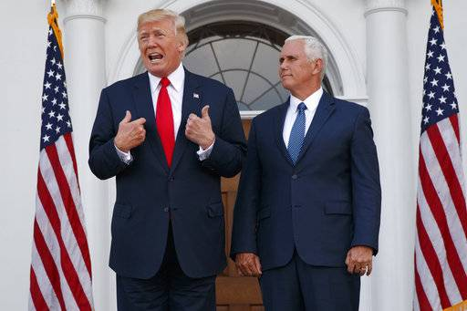 "In this Aug. 10, 2017, photo, President Donald Trump, accompanied by Vice President Mike Pence, speaks to reporters before a security briefing at Trump National Golf Club in Bedminster, N.J. Pence departs Sunday for Latin America, a trip that comes on the heels of yet another provocative statement fromTrump that Pence is sure to have to answer for: this time Trump's sudden declaration that he would not rule out a ""military option� in Venezuela, where president Nicolas Maduro has been consolidating power, plunging the country into chaos."