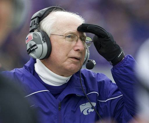 FILE - In this Oct. 6, 2012, file photo, Kansas State coach Bill Snyder watches a replay on the scoreboard during the second half of an NCAA college football game against Kansas, in Manhattan, Kan. Kansas State coach Bill Snyder is back for another season, despite a cancer scare earlier this year. The 77-year-old coach believes he has a team capable of contending for a Big 12 title and even a national championship, and no amount of chemotherapy was going to keep him from leading the Wildcats for the 26th year.