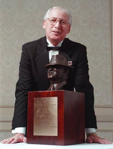"FILE - In this Dec. 10, 1998, file photo, Kansas State University NCAA college head football coach Bill Snyder poses with the 1998 Paul ""Bear"" Bryant Coach of the Year Award, in Houston. Snyder was hired at Kansas State in 1988, when new Oklahoma coach Lincoln Riley was 5 years old, and will begin his 26th season on Sept. 2 with a team expected to once again contend for a title."