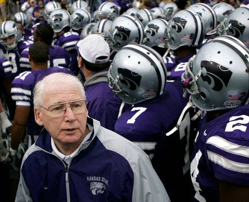 FILE - In this Nov. 19, 2005, file photo, Kansas State coach Bill Snyder waits with his team to take to the field before a college football game against Missouri, in Manhattan, Kan. Snyder tried the retirement route in 2005 and it lasted three years. He simply couldn't stay away.