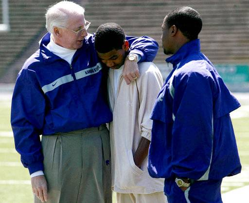 FILE - In this May 1, 2004, file photo, Kansas State coach Bill Snyder talks with running back Darren Sproles, right, and his brother Terence Sproles before Kansas State's spring game in Manhattan, Kan. The 77-year-old Snyder's name now adorns the football stadium, where about $200 million in recent renovations have turned it into a jewel of the Flint Hills. The Hall of Famer's life-sized statue stands sentinel at the front gates, and a short drive away is a highway bearing his name. His shadow falls heavily across the entire Big 12. Indeed, all of college football.
