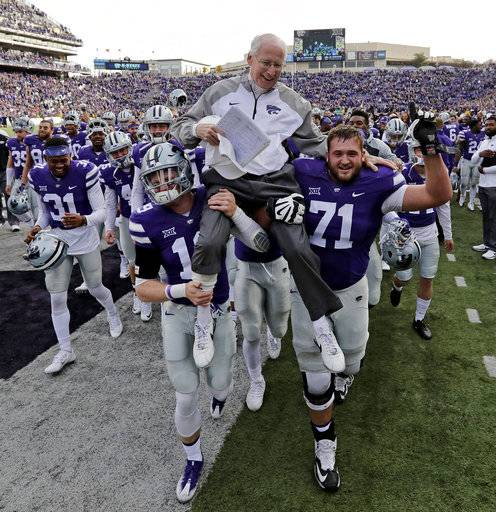 "FILE - In this Nov. 26, 2016, file photo, Kansas State head coach Bill Snyder is carried off the field after getting his 200th career coaching win after beating Kansas, 34-19, in an NCAA college football game in Manhattan, Kan. Snyder likes to spin a well-worn story about an old man from western Kansas, who had driven through the night many years ago to visit Kansas State's coach after a victory in the Copper Bowl. They chatted about family and life. Hopes and dreams. Then, the man said the Wildcats' bowl victory was ""the greatest experience of my life,� words that stick with Snyder to this day.  ""That,� Snyder said, ""made me understood what this all means.�"