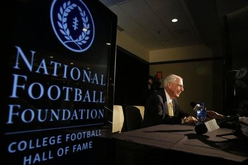 FILE - In this Jan. 9, 2015, file photo, Kansas State head football coach Bill Snyder speaks to reporters after a news conference announcing the 2015 College Football Hall of Fame Class in Dallas. Kansas State coach Bill Snyder is back for another season, despite a cancer scare earlier this year. The 77-year-old coach believes he has a team capable of contending for a Big 12 title and even a national championship, and no amount of chemotherapy was going to keep him from leading the Wildcats for the 26th year.