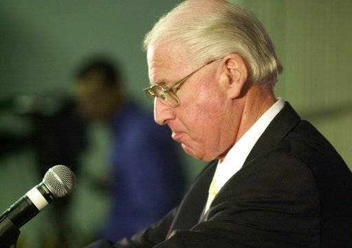 FILE - In this Nov. 15, 2005, file photo, Kansas State football coach Bill Snyder holds back tears as he announces that he will step down and retire after Saturday's game with Missouri, in Manhattan, Kan.  He simply couldn't stay away, despite changes in major college football that have caused him much anxiety over the years. ( Jeff Tuttle/The Wichita Eagle via AP)