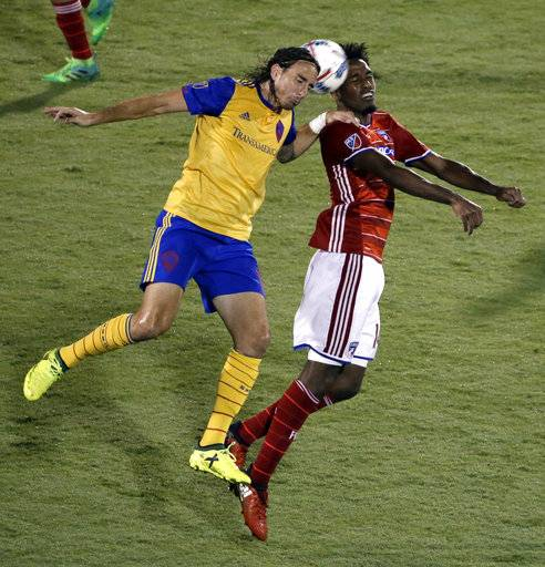 Colorado Rapids forward Alan Gordon, left, and FC Dallas defender Atiba Harris compete for a head ball during the second half of an MLS soccer match, Saturday, Aug. 12, 2017, in Frisco, Texas.