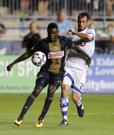 Philadelphia Union's Joshua Yaro, left, and Montreal Impact's Matteo Mancosu vie for the ball during the first half of an MLS soccer match Saturday, Aug. 12, 2017, in Chester, Pa. The Impact won 3-0.