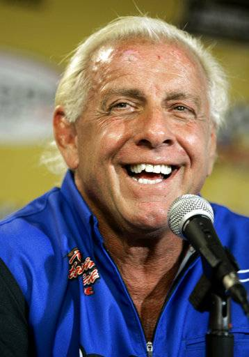"FILE - In this Sept. 22, 2007, file photo, wrestler Ric Flair addresses the media during a news conference at Dover International Speedway in Dover, Del. Flair's representative said on Twitter Aug. 14, 2017, that Flair was dealing with some ""tough medical issues."" (AP Photo/Carolyn Kaster, File)"