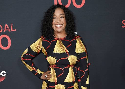 "FILE - In this April 8, 2017, file photo, Shonda Rhimes attends the ""Scandal"" 100th Episode Celebration at Fig & Olive in West Hollywood, Calif. Netflix announced late Sunday, Aug. 13, that Rhimes and her company Shondaland had agreed to produce new series and context for the streaming service. Rhimes' current hit shows, ""Grey's Anatomy,� ""Scandal� and ""How to Get Away With Murder,� will continue to air on ABC. (Photo by Richard Shotwell/Invision/AP, File)"