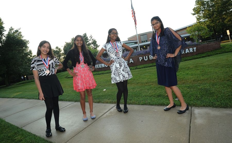 Krishna Patel, 14, right, of Buffalo Grove; Ojasvi Saxena, 14, of Buffalo Grove; Rishika Chikoti, 14, of Hawthorn Woods; and Aditi Singh, 14, also of Hawthorn Woods, took third place in the National History Day competition for their website, which featured research on Eliot Ness, who fought to bring Chicago mobster Al Capone to justice during Prohibition. They did research at the Vernon Area Public Library.