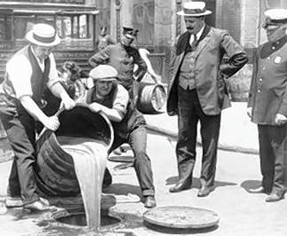 Liquor is poured into a sewer after a raid in 1921.