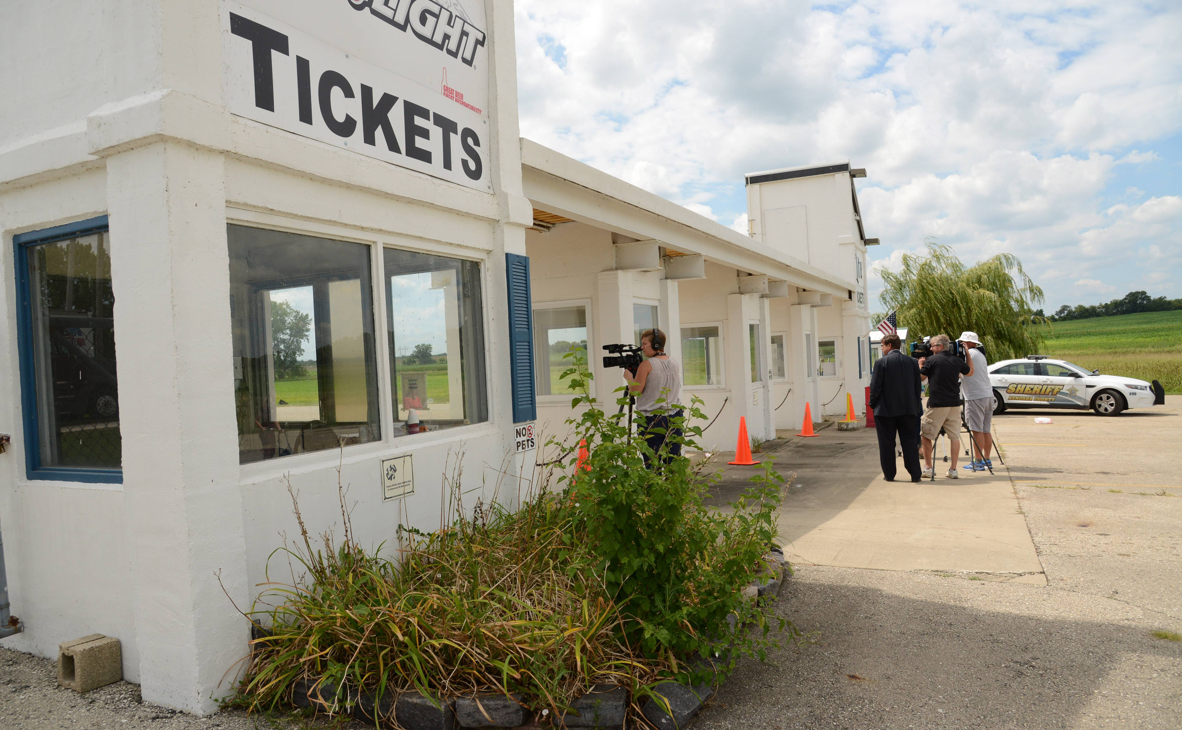 The main entrance to the Great Lakes Dragaway is guarded Monday by Kenosha County sheriff's deputies after Sunday night's shooting.