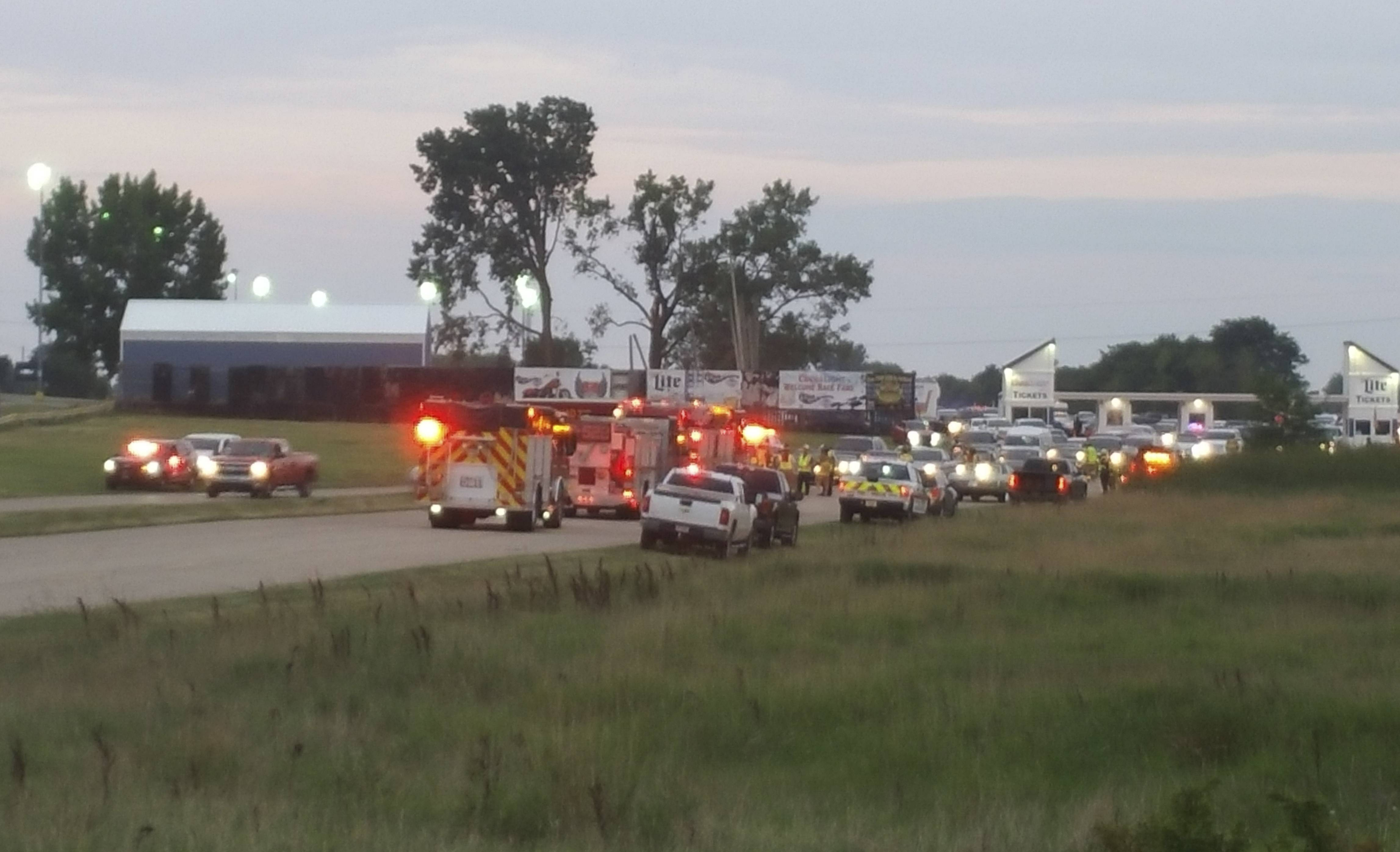 Emergency response vehicles gather Sunday at Great Lakes Dragway near Union Grove, Wisconsin. Three men were shot and killed during an auto racing event at the facility, authorities said.