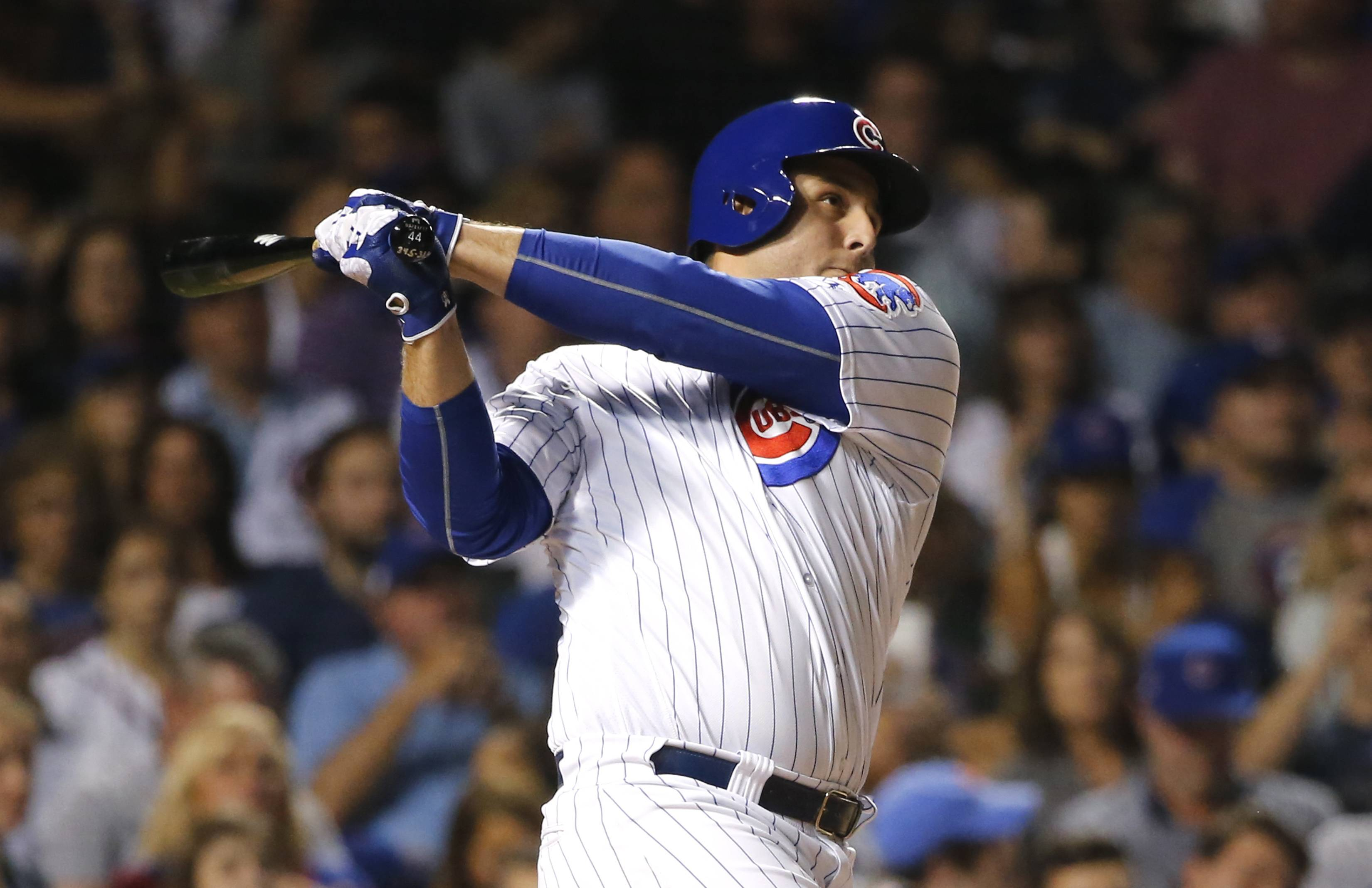 Chicago Cubs' Anthony Rizzo watches his home run off Cincinnati Reds' Asher Wojciechowski during the fourth inning Monday at Wrigley Field.