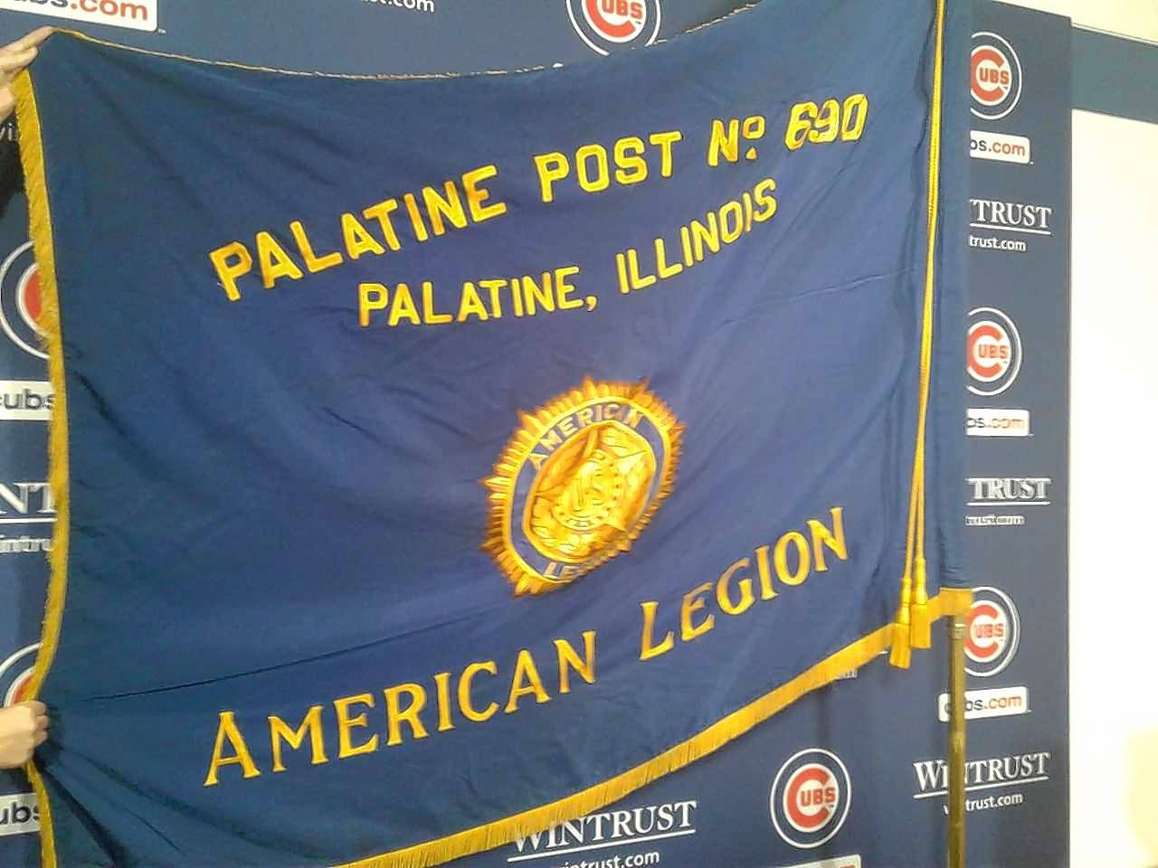 Chicago Cubs manager Joe Maddon on Monday unfurled the banner of Palatine Post 690 as he observes American Legion Week.
