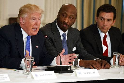 "FILE - In this Thursday, Feb. 23, 2017, file photo, President Donald Trump, left, speaks during a meeting with manufacturing executives at the White House in Washington, including Merck CEO Kenneth Frazier, center, and Ford CEO Mark Fields. Frazier is resigning from the President's American Manufacturing Council citing ""a responsibility to take a stand against intolerance and extremism."" Frazier's resignation comes shortly after a violent confrontation between white supremacists and protesters in Charlottesville, Va. Trump is being criticized for not explicitly condemning the white nationalists who marched in Charlottesville. (AP Photo/Evan Vucci, File)"