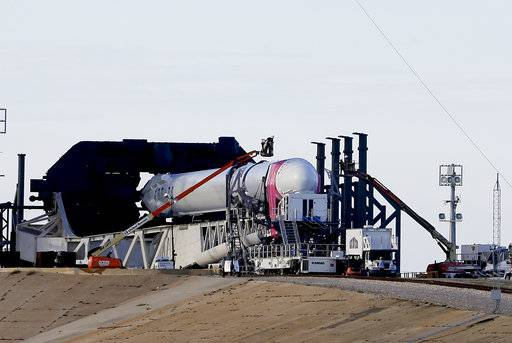 Final preparations are made to the Falcon 9 SpaceX rocket on pad 39A for Monday's scheduled launch at Kennedy Space Center in Cape Canaveral, Fla., Sunday, Aug. 13, 2017. The spacecraft is set for a cargo delivery mission to the International Space Station. (AP Photo/John Raoux)
