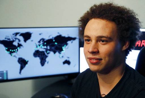 FILE - This Monday, May 15, 2017, file photo shows British IT expert Marcus Hutchins, branded a hero for slowing down the WannaCry global cyberattack, during an interview in Ilfracombe, England. Prosecutors have charged Hutchins and an unnamed co-defendant with conspiring to commit computer fraud in the state and elsewhere. Hutchins could enter a plea during a hearing Monday, Aug. 14, in Wisconsin federal court. (AP Photo/Frank Augstein, File)