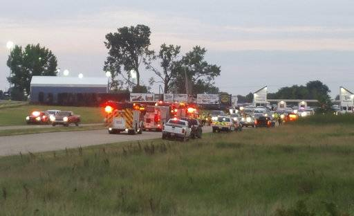 Emergency response vehicles gather at Great Lakes Dragaway on Sunday, Aug. 13, 2017, near Union Grove, Wis. Three men were shot and killed during an auto racing event at the facility, a Wisconsin sheriff said. Kenosha County Sheriff David Beth said authorities responded around 7 p.m. after receiving reports about shots being fired. The three men were shot by another man at point-blank range near a food vendor, Beth said at a news conference Sunday night. No suspects were arrested and no one else was injured. (Terry Flores/Kenosha News via AP)