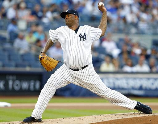 FILE - In this Aug. 1, 2017, file photo, New York Yankees starting pitcher CC Sabathia winds up during the first inning of the team's baseball game against the Detroit Tigers, at Yankee Stadium in New York. Sabatthia was put on the 10-day disabled list because of right knee inflammation and left-hander Jordan Montgomery was recalled from Triple-A Scranton/Wilkes-Barre. (AP Photo/Kathy Willens. File)