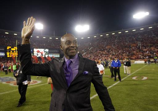 FILE - In this Dec. 23, 2013, file photo, former San Francisco 49ers player Jerry Rice waves to the crowd at Candlestick Park after an NFL football game between the 49ers and the Atlanta Falcons in San Francisco. Rice put on the cleats and took part in practice with the 49ers on Monday, Aug. 14, 2017, running patterns and doing stretches in individual drills, dishing out tips to young receivers and even shadowing the wideouts during team drills. (AP Photo/Marcio Jose Sanchez, File)