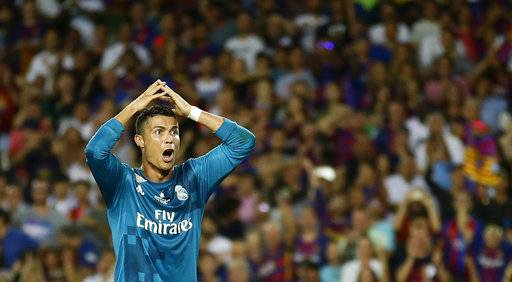 In this photo taken on Sunday, Aug. 13, 2017, Real Madrid's Cristiano Ronaldo reacts after being shown a second yellow card by referee Ricardo de Burgos during the Spanish Supercup, first leg, soccer match between FC Barcelona and Real Madrid at the Camp Nou stadium in Barcelona, Spain. Cristiano Ronaldo was banned for five games on Monday after shoving a referee following his red card for diving in Real Madrid's 3-1 win over Barcelona in the season-opening Spanish Super Cup. (AP Photo/Manu Fernandez)