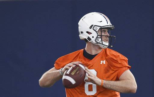 FILE - This Feb. 28, 2017, file photo shows Auburn quarterback Jarrett Stidham working out during the first day of spring football practice at the Auburn Athletics Complex in Auburn, Ala. (Julie Bennett /AL.com via AP)