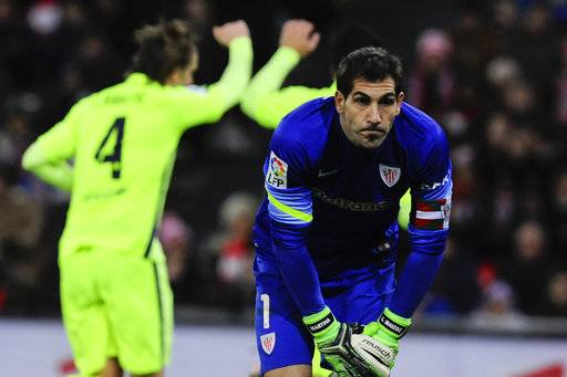 FILE - In this Sunday, Feb. 8, 2015 file photo, Athletic Bilbao goalkeeper Gorka Iraizoz looks up after FC Barcelona scored their fifth goal during their La Liga soccer match, at San Mames stadium in Bilbao, northern Spain. The only complete newcomer to Spain's first division, Girona has a big brother behind it to help it take its first steps. City players Marlos Moreno, Douglas Luiz and Aleix Garcia have arrived on loan this summer, joining the club's signings of striker Christian Stuani (Middlesbrough), goalkeeper Gorka Iraizoz (Ahtletic Bilbao), and Farid Boulaya (Bastia). Marc Muniesa has also joined on loan from Stoke City. (AP Photo/Alvaro Barrientos, file)