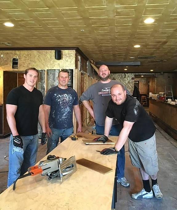 Kevin Hahn, left, brother Brian Hahn, Chris Dodsworth and Scott Fisher are owners of the new Main Street Pub in St. Charles