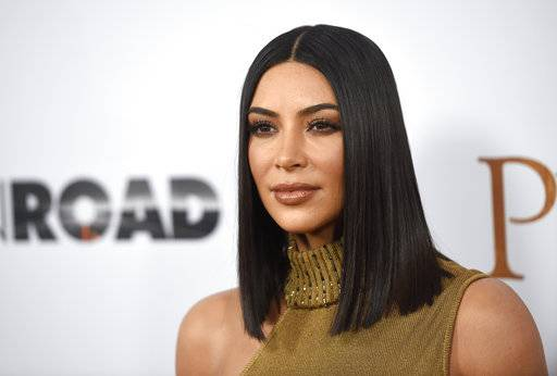 "FILE - In this April 12, 2017, file photo, Kim Kardashian West arrives at the U.S. premiere of ""The Promise"" at the TCL Chinese Theatre in Los Angeles. Kardashian West was trending on social media after defending makeup artist Jeffree Star as an asset to her cosmetics empire despite his history of racist remarks and calling her fans ""petty� for bringing up his past. Kardashian West said in a Snapchat video Tuesday, Aug. 15, that she's sorry for ""feeling like I had the right to say 'get over it' in a situation that involves racism.� (Photo by Chris Pizzello/Invision/AP, File)"