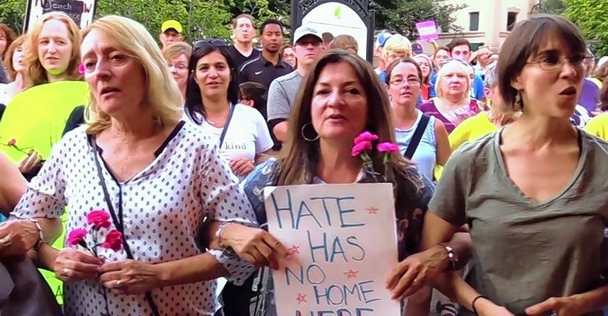 More than 200 people attended a Monday night vigil in Naperville in support of the victims of violence in Charlottesville, Virginia.