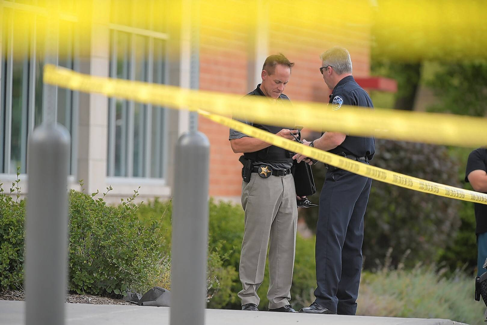 Investigators work the scene of a shooting Monday at Roselle and Wise roads in Schaumburg.