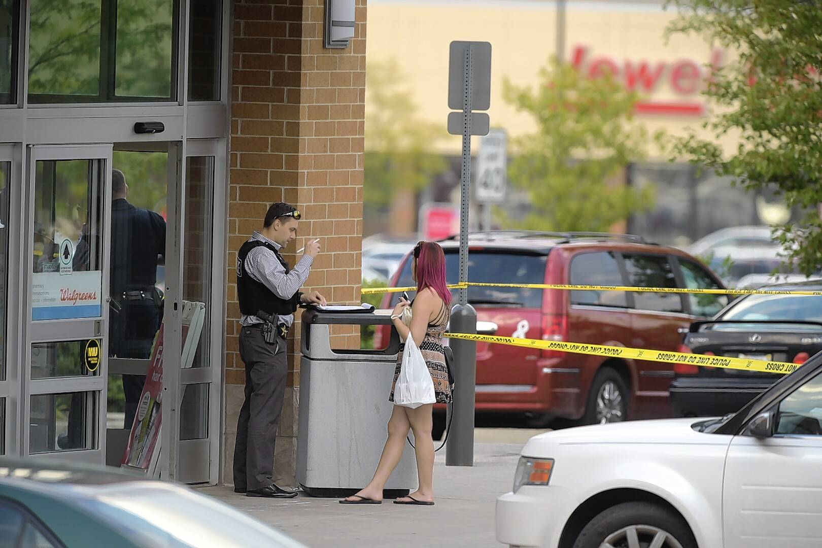 Investigators worked the scene of a shooting Monday in a Walgreens parking lot off Roselle and Wise roads in Schaumburg.